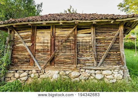Old Serbian rural traditional wooden corn bar