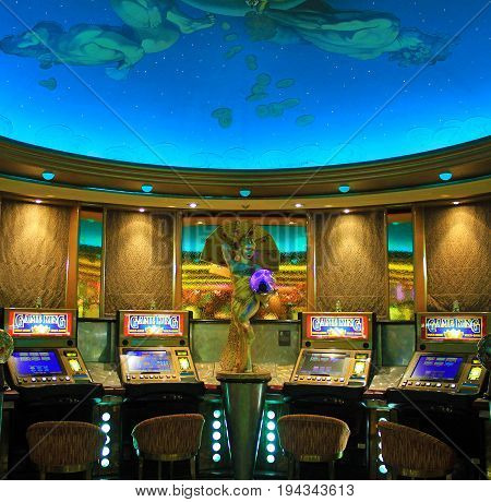 cruise liner Vision of the Seas - July 8, 2017: Gaming slot machines in American gambling casino in the cruise liner Vision of the Seas of Royal Caribbean International, USA.
