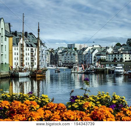 Alesund, Norway - July 7, 2017: Seafront of town and sea port Alesund, Norway.
