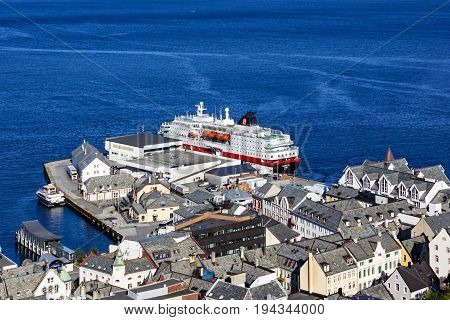 Alesund, Norway - July 3, 2017: Fjords and cruise vessel Hurtigruten from Aksla mountain in Alesund, Norway.