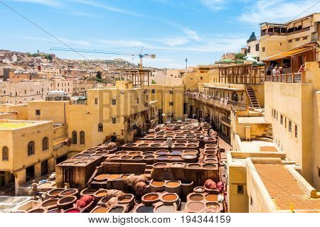 Fez Morocco - May 07 2017: Workers are dyeing leather at the tannery in Fez Fes el Bali Morocco Africa