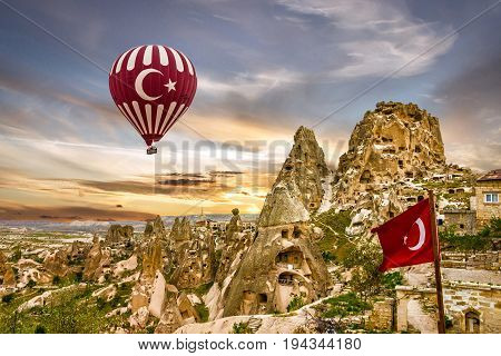 Cappadocia, Turkey. Hot air balloon landscape. Turkish fortress Uchisar, Anatolia
