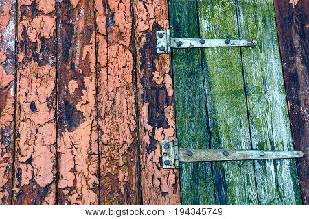 Wooden color texture of old boards with iron loops
