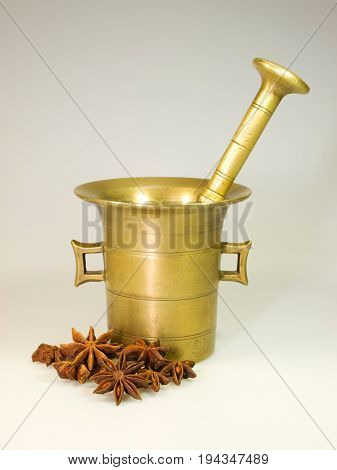 Vintage old bronze mortar with star-anise spice