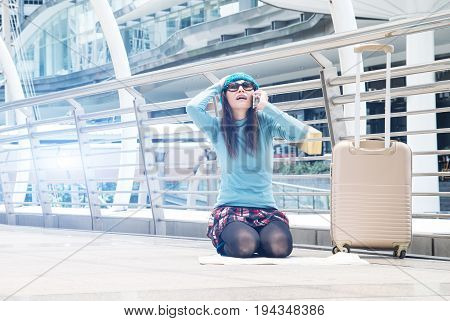 tourists girl asian searching location in a guide map and smart phone with airport in the background