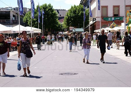 MAINZ, GERMANY - JUNE 26: Families and visitors at the Festival Mainz Johannes Night passes snack bars and beer gardens on June 26, 2017 in Mainz.