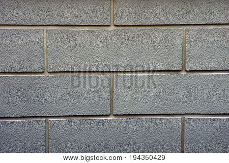Stone texture of a gray brick wall at home