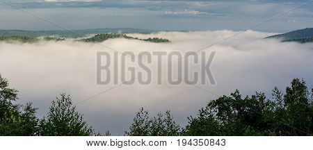 Belgian countryside - Ardennes. View over the Semois valley covered by clouds in the Belgian Ardennes in the morning.