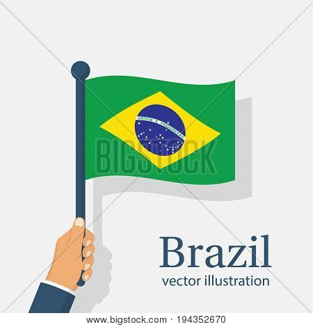 Brazil flag holding in hand. Brazil Independence Day 7th september. Vector illustration flat design. Isolated on white background. National holiday. Celebrated annually. Waving flag in wind.