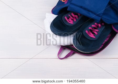Blue backpack for sports with things idea on gray board