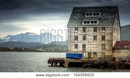 An old fishing warehouse on the ocean. Norway. Alesund