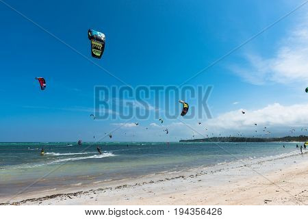 BORACAY, WESTERN VISAYAS, PHILIPPINES - JANUARY 11, 2015: Blue sky with people doing kiteboarding and windsurfing during summer time at Bulabog Beach.