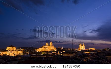 Night view of Salamanca cityscape:the Cathedral, the Pontifical University and Dominican monastery of San Esteban illuminated. The Old city of Salamanca is declared by UNESCO a World Heritage Site.
