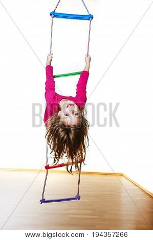 happy little girl climbing on a ladder
