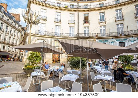 NANTES, FRANCE - May 27, 2017: View on the crowded with tourists Graslin square with restaurants and cafes in Nantes city in France