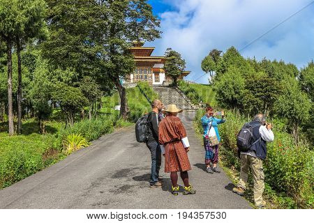 Thimphu, Bhutan - September 10, 2016: Tourists Taking Photos Near Druk Wangyal Lhakhang Temple, Doch