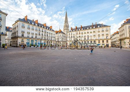 NANTES, FRANCE - May 27, 2017: View on the Royale square with fountain and church tower in Nantes city in France