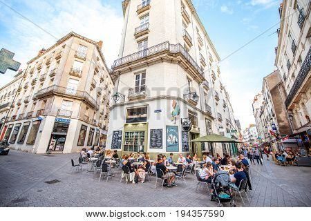 NANTES, FRANCE - May 27, 2017: Street view with cafes and restaurant full of people in the old town of Nantes city in France