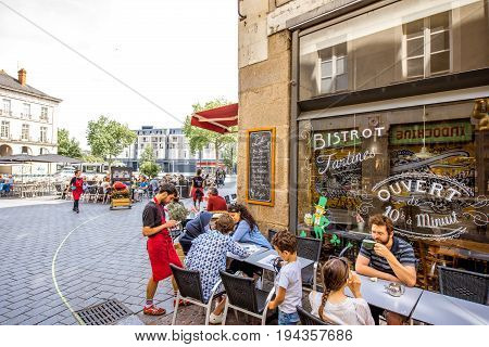 NANTES, FRANCE - May 28, 2017: Street view with cafes and restaurant full of people in the old town of Nantes city in France