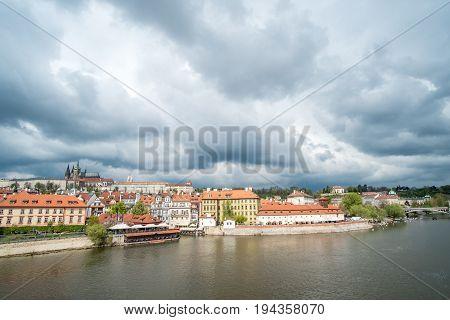 View Of Building Along Vltava River, From Charles Bridge In Prague, Czech Republic.