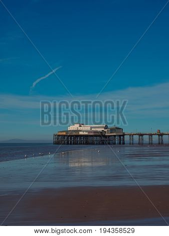 North Pier in Blackpool with outgoing tide