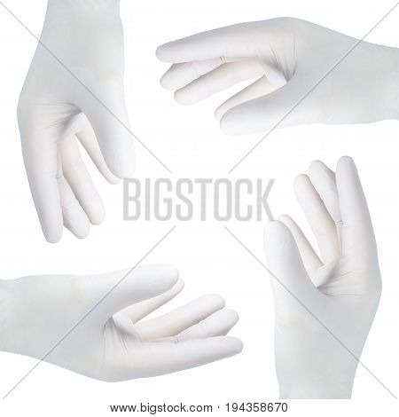 Four hands in gloves against white background.
