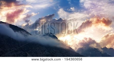 Mountain Landscape With Tops In Clouds