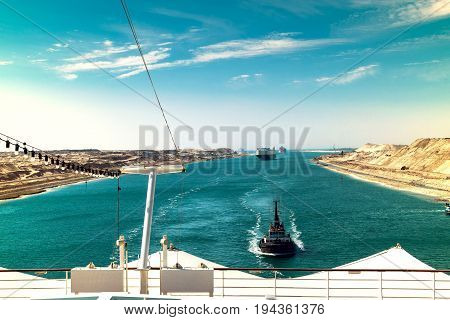 The Suez Canal - a ship convoy with a cruise ship passes through the new eastern extension canal opened in August 2015