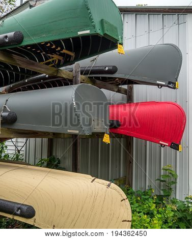 Canoes on a rack for sale - multicolored