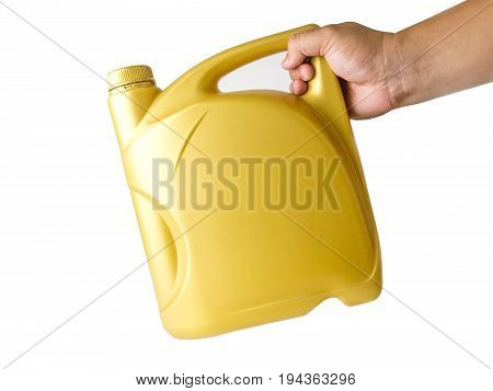 A canister with engine oil in a hand isolated on white background.