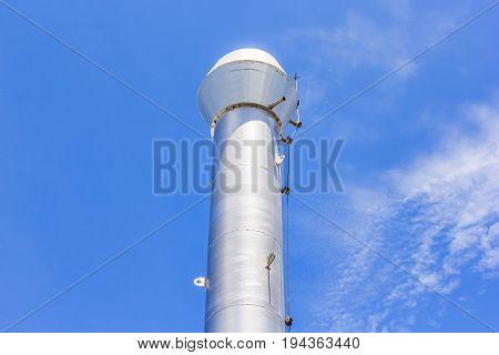 Industrial boiler flues against the blue sky