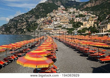 Positano beach waiting for the sun worshippers to arrive. The town of Positano in the background.
