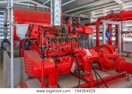 Industrial fire pump station for water sprinkler piping and fire alarm control system. Pipelines water pump valves manometers.