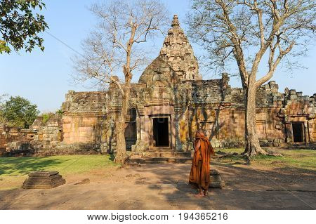 Phantom Rung, Thailand - 1 February 2012: monk walking in front of Phanom Rung hindu temple on Thailand