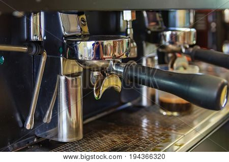 Coffee machine preparing coffee in cafe automatic espresso machine pouring coffee in cup at restaurants Coffee and tools