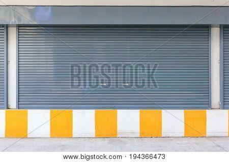 Steel roller shutter automatic door on the street.