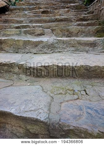 Stone Stair With Cemented Grey Steps Pattern. Brown Staircase Rising Up With Moss Texture. Several S