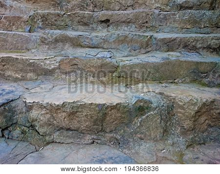Stone Stair With Cemented Grey Steps Pattern. Brown Staircase Rising Up With Stains Texture. Several
