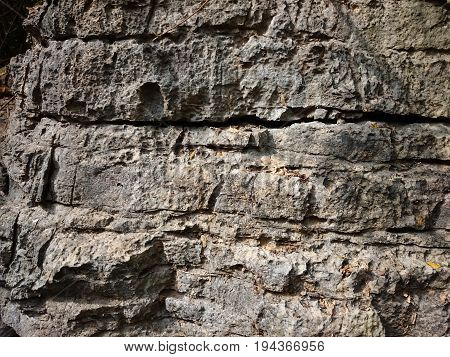 Old Stone Background Texture. Cave Wall Rusty Pattern Scratched With Cracks. Grey Ancient Rock With
