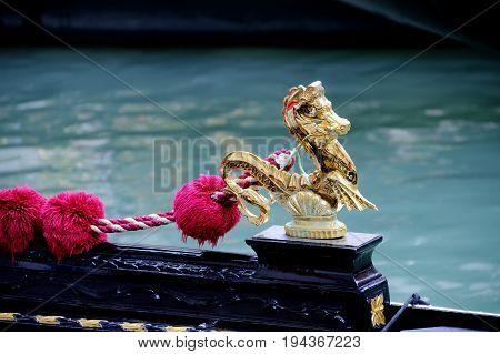 Close up of the sea horse ornament of a gondola.