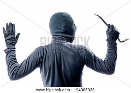 View From The Back Of A Criminal In A Balaclava With His Hands Raised On A White Background