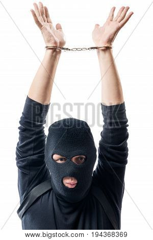 Dangerous Offender In Handcuffs, Hands Over Head On A White Background