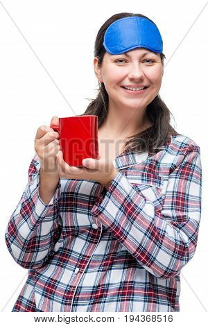 Portrait Of A Smiling Woman With A Cup Of Coffee, Dressed In Pajamas With A Mask For Eyes On A White