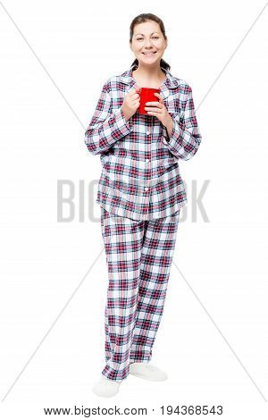 Cheerful Girl In Pajamas With A Mug Of Coffee On A White Background In Full Length