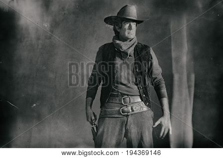Old Worn Wet Plate Photo Of Western Actor. Picking Revolver From Holster.
