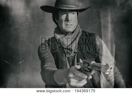 Antique Worn Wet Plate Photo Of Vintage Western Actor. Shooting With Revolver.