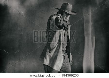 Wet Plate Photo Of Vintage Western Actor. Shooting With Revolver.