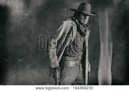Old Weathered Wet Plate Photo Of Western Actor. Picking Revolver From Holster.