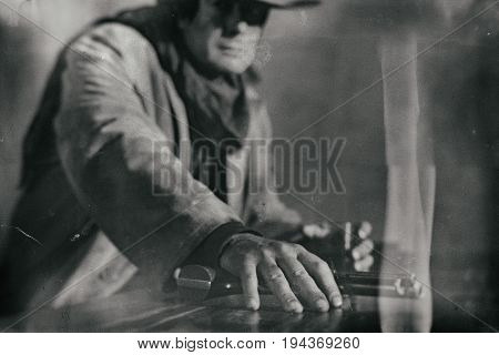 Old Wet Plate Photo Of Vintage Western Actor Sitting At Bar Holding Revolver.