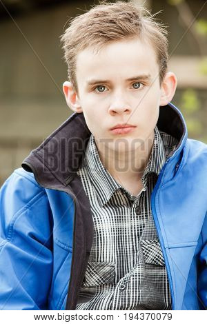 Angry Brown Haired Boy Wearing Blue Jacket